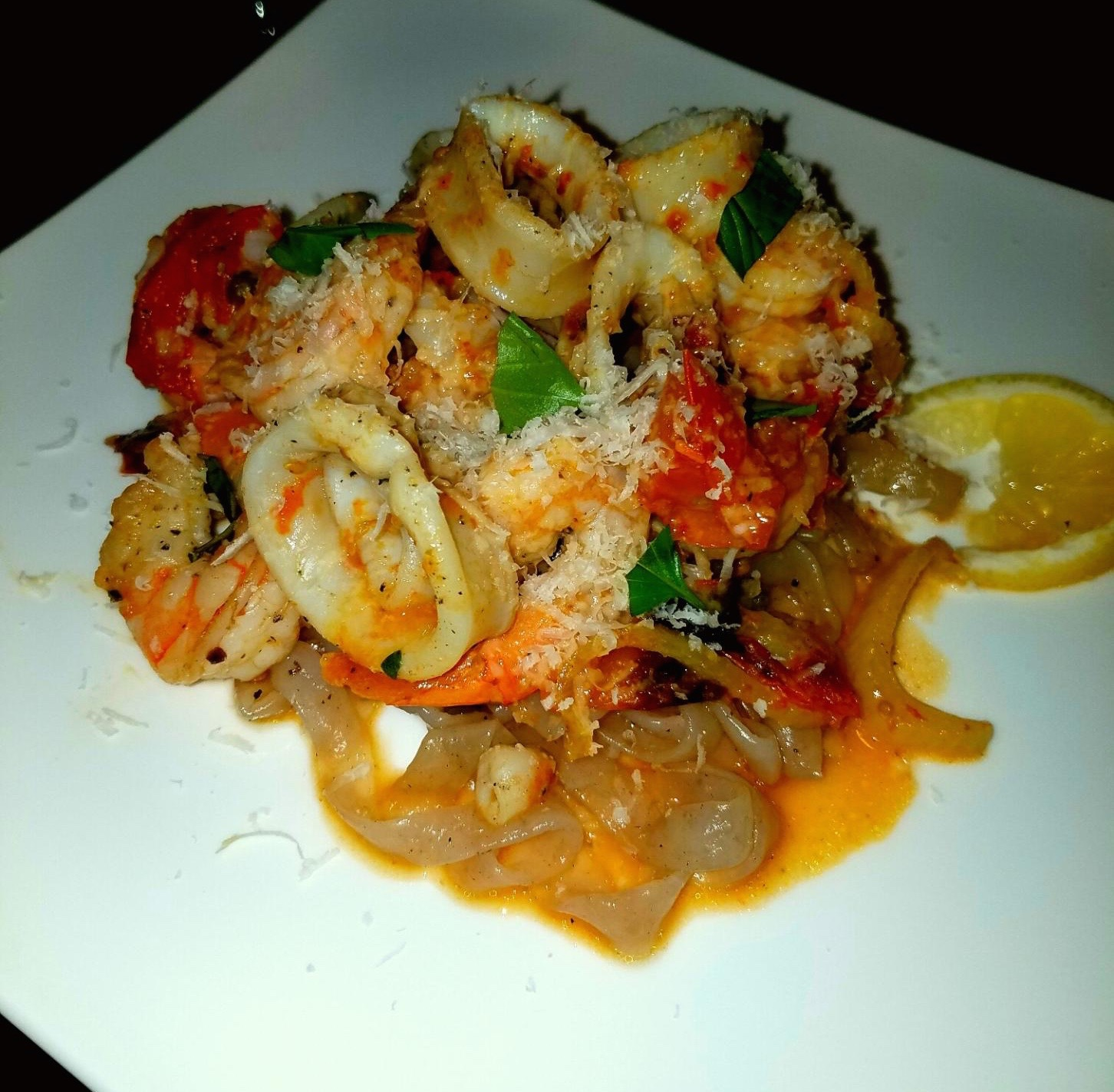 Calamari and shrimp in roasted baby heirloom caper fennel white wine sauce