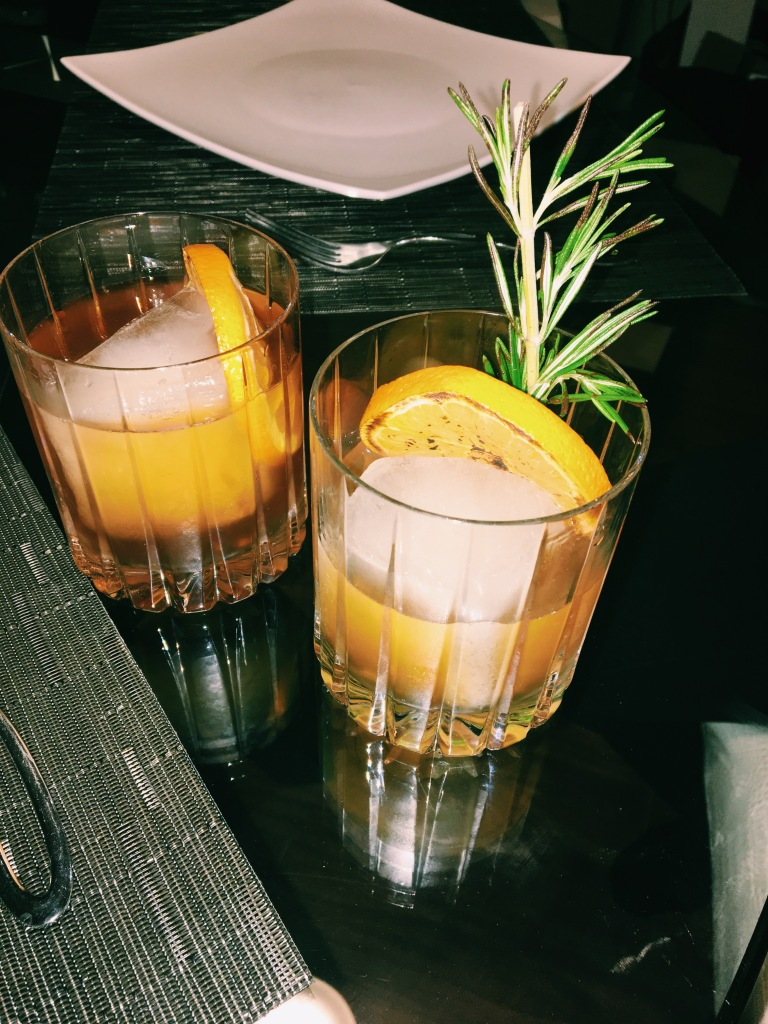Walnut Bourbon Cocktail with Bruleed Orange and Rosemary