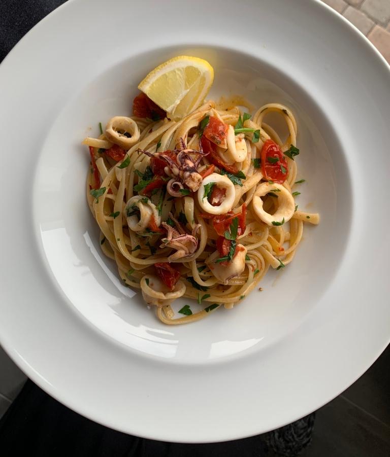 Linguine, calamari, lemon, tomatoes and white wine