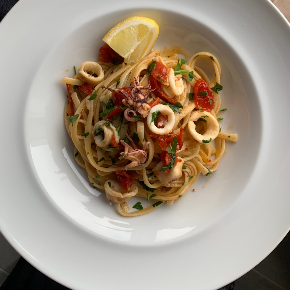 Linguine, calamari, lemon, tomatoes and white wine