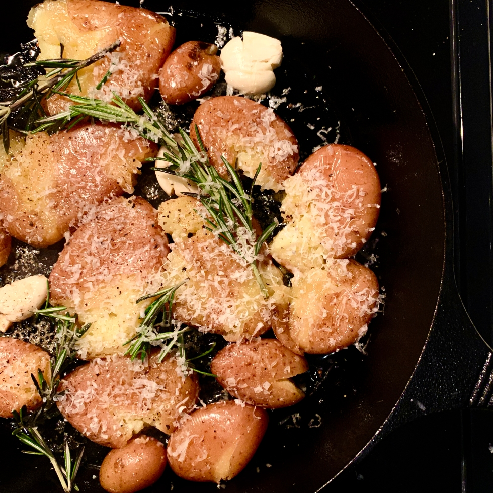 Crispy Cast Iron Garlic Parm Smashed Potatoes